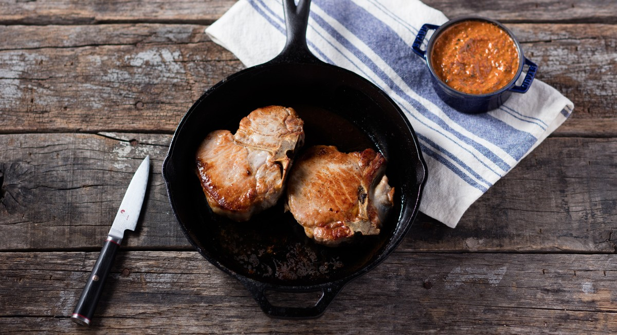 Pork chops with walnut romesco sauce