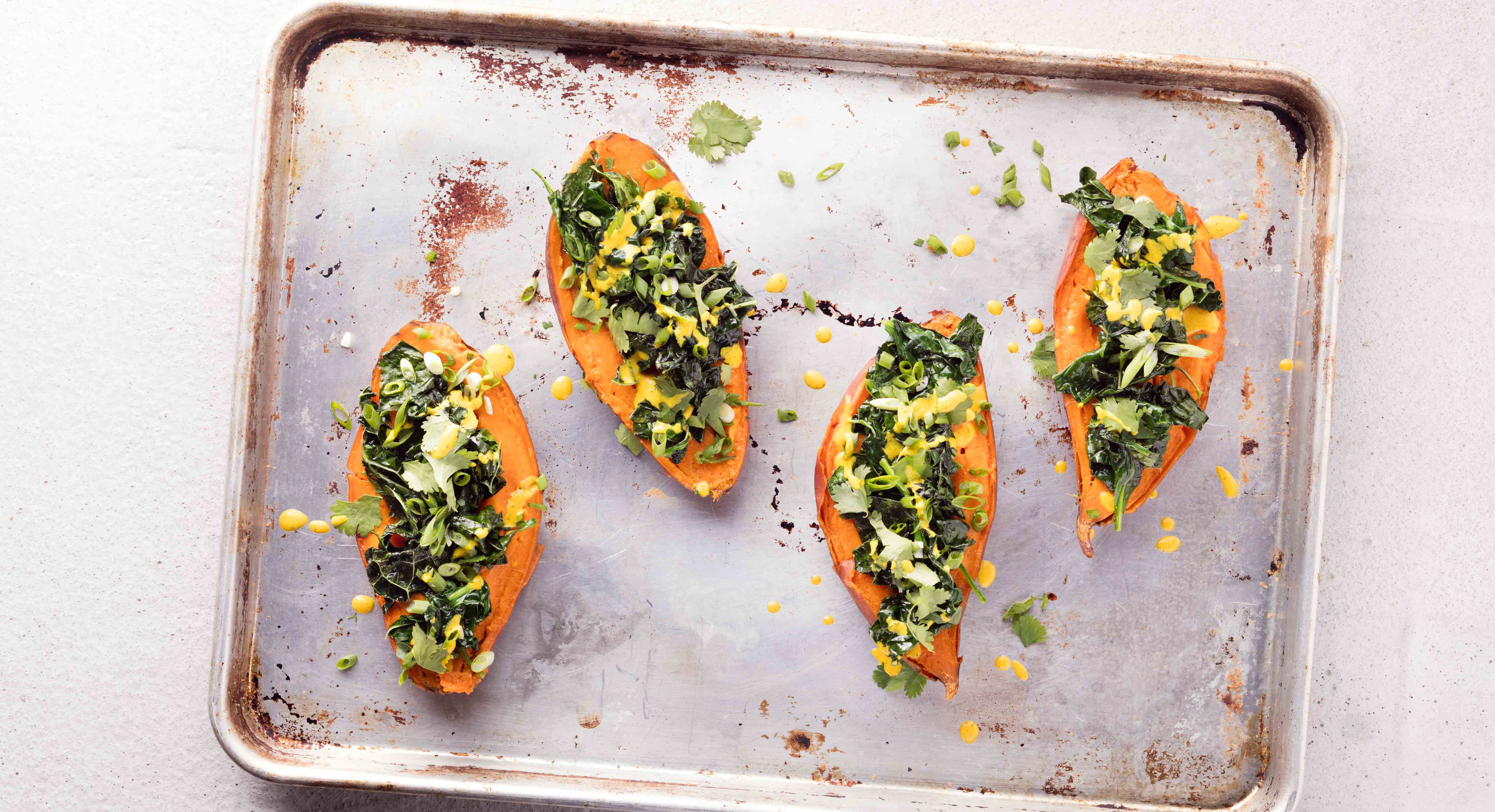 Stuffed Sweet Potatoes Get a Big Upgrade With Avocado and Tahini-Turmeric Dressing