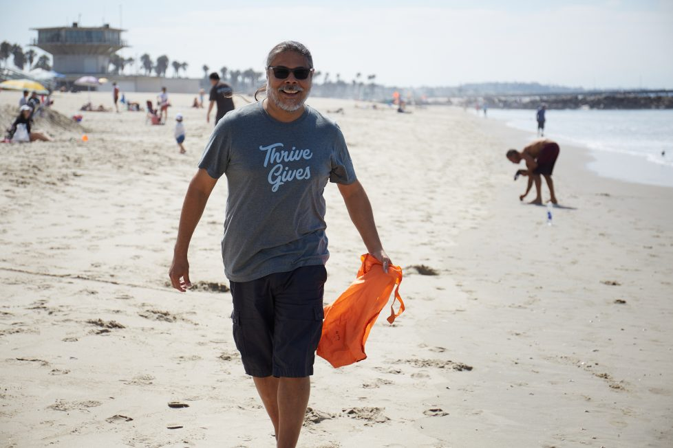 Thrive Surfrider Love cleaning up