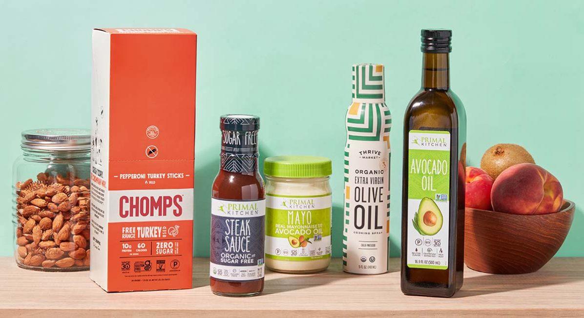 Image of a shelf with keto pantry staples, like avocado oil, mayo, sugar-free steak sauce, and almonds